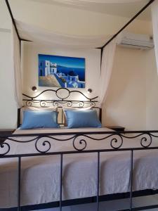 A bed or beds in a room at Villa Irini Studios