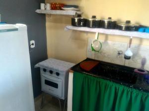 A cozinha ou cozinha compacta de Alto Paraíso Flats