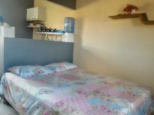 Cama ou camas em um quarto em Alto Paraíso Flats