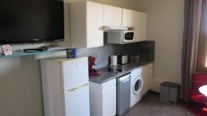 Cuisine ou kitchenette dans l'établissement Au Remp'Arts