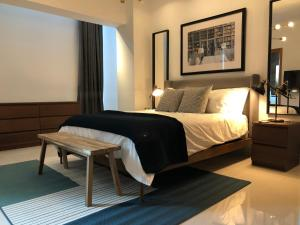 A bed or beds in a room at LOFT in Piantini | City Views
