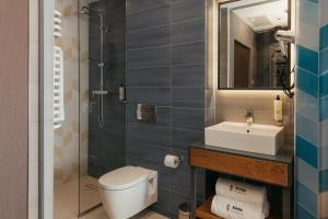 A bathroom at Avena by Artery Hotels
