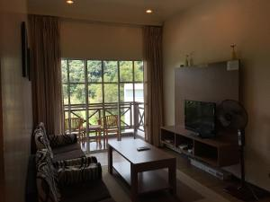 A seating area at CH Green Stay Resort Apartment