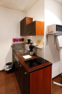 Küche/Küchenzeile in der Unterkunft City Apartments Gladenbach