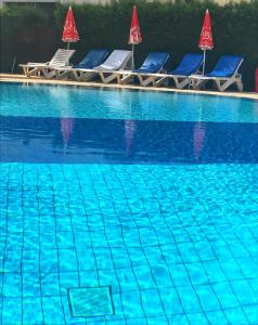 The swimming pool at or near Pigeon Beach Hotel Apartments