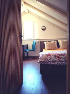 A bed or beds in a room at Apartments Rector's Villa