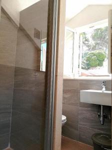 A bathroom at Apartments Rector's Villa