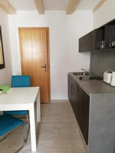 A kitchen or kitchenette at Apartments Rector's Villa