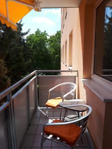 Ein Balkon oder eine Terrasse in der Unterkunft Apartment Nannerl
