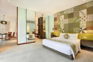 A bed or beds in a room at The Elysian Boutique Villa Hotel