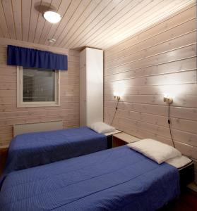 A bed or beds in a room at Himosport Apartments
