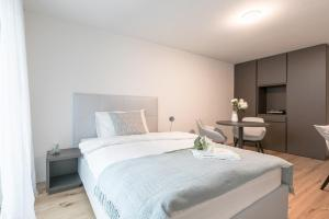 A bed or beds in a room at Airport Apartments Zürich Kloten