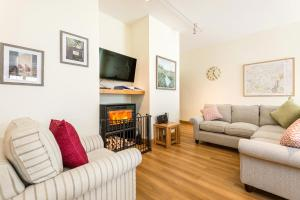 A seating area at Wallops Wood Cottages