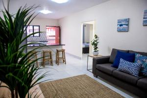 A seating area at The Living Collective Apartments