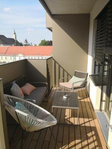 A balcony or terrace at Vienna City Apartment