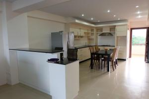 A kitchen or kitchenette at Rawai Suites Phuket
