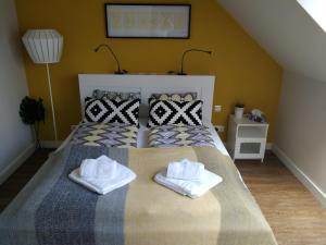 Кровать или кровати в номере Zsinkó Villa