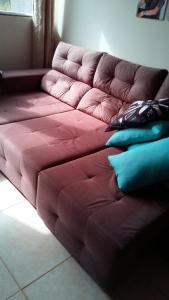 A bed or beds in a room at Casa Nova Ótima Escolha
