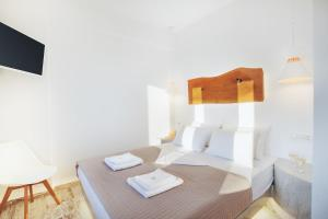 A bed or beds in a room at Nectarios Villa - Studios & Suites