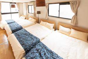 Condominium Tsudoi Fukuokaにあるベッド