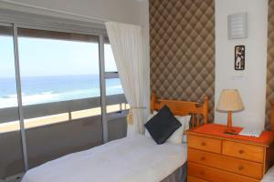 A bed or beds in a room at Silver Dolphin Holidays