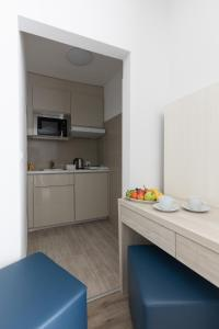 A kitchen or kitchenette at Residence Mutschellen