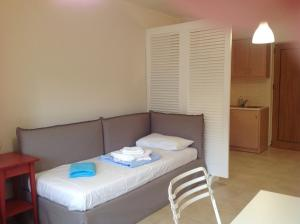 Een bed of bedden in een kamer bij Arkadia