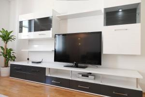 A television and/or entertainment center at Sunny Apartments - Schoenbrunn