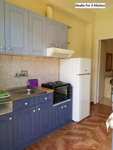 A kitchen or kitchenette at Varvara Studios & Apartments II