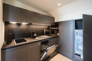 A kitchen or kitchenette at Apartment Wellness Essense