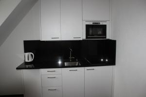 A kitchen or kitchenette at Seefeld Appartement