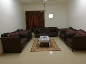A seating area at AL Faridah Furnished Units