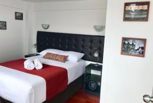 Cama o camas de una habitación en Luxury Inka Apartments