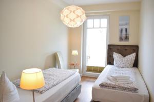 Ein Bett oder Betten in einem Zimmer der Unterkunft Villa Ocean Place