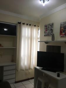 A television and/or entertainment centre at Um lugar especial para sua estadia em Brasília