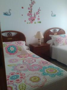 A bed or beds in a room at Juami