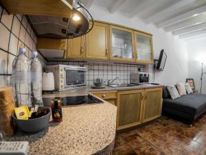 "A kitchen or kitchenette at LOC Hospitality ""Venetian Well Square"" family maisonette"
