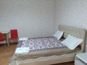 A bed or beds in a room at AziaWay Apart-Hotel
