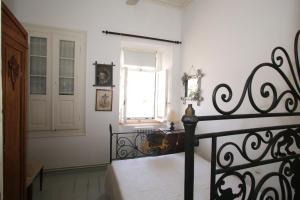Ένα ή περισσότερα κρεβάτια σε δωμάτιο στο Traditional House