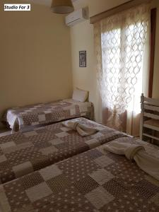 A bed or beds in a room at Varvara Studios & Apartments II