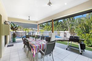 A restaurant or other place to eat at Tropical private holiday house with pool