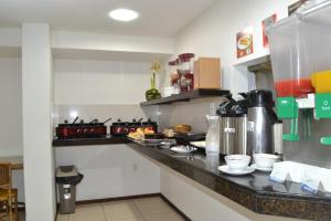 A kitchen or kitchenette at Ametista Flat