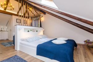 Posteľ alebo postele v izbe v ubytovaní Apartments Racic