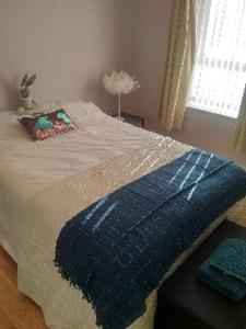 A bed or beds in a room at 21a Seahill Road, Holywood
