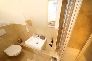A bathroom at Planet Berlin City Apartments
