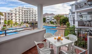 A balcony or terrace at Apartamentos Hg Tenerife Sur