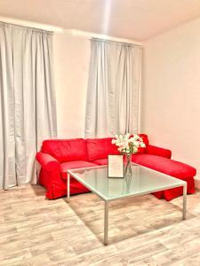 Ein Sitzbereich in der Unterkunft S&S Riverside Apartments
