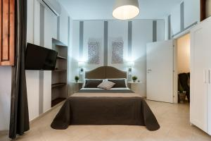A bed or beds in a room at Stampace Apartments