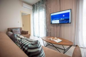 A television and/or entertainment centre at Blue Ark Elegant Athens 1&2