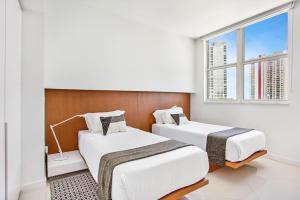 Cama ou camas em um quarto em OB Suites Brickell Miami